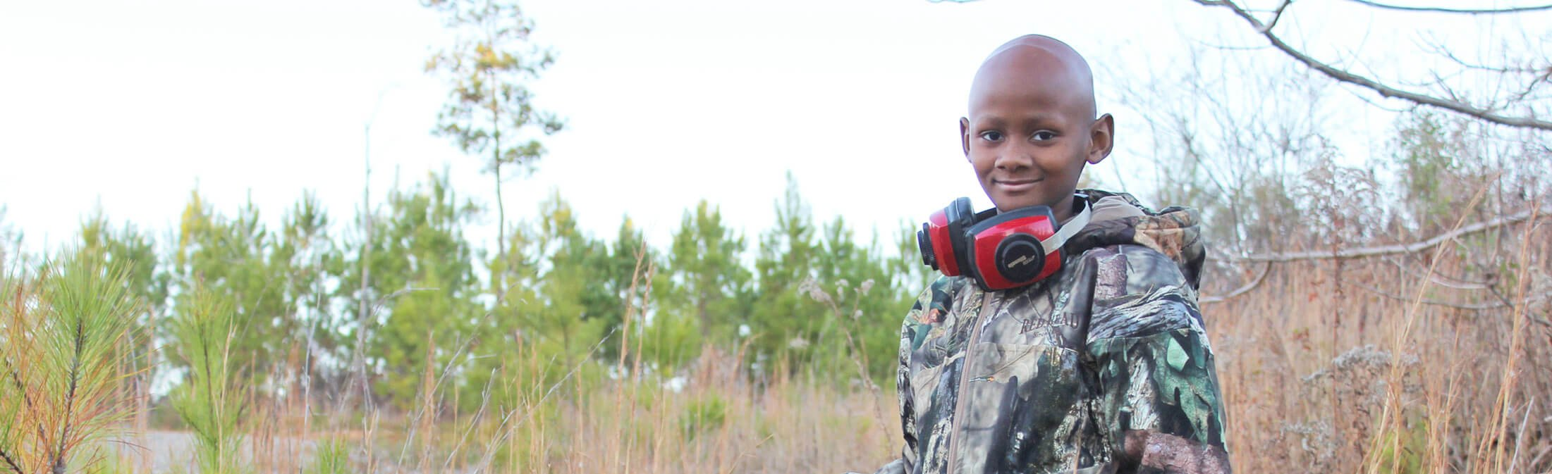 Catch-A-Dream child pauses to reflect on hunting adventure